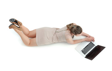 Woman with a laptop lying on the floor
