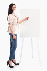 Young woman standing near board