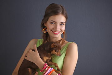 Girl with a dog grey background