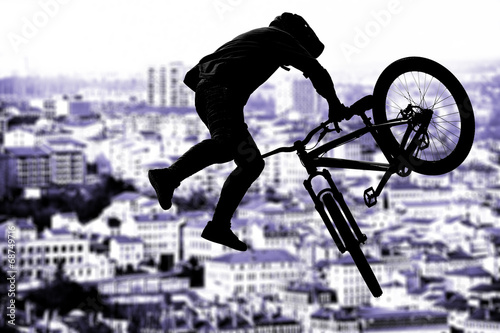Silhouette bmx sport rider in action with scenery background - 68749716