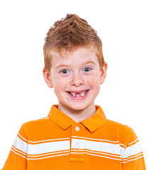 Portrait of a cute red-haired boy