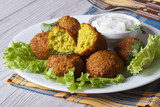 falafel on lettuce with tzatziki sauce close-up horizontal