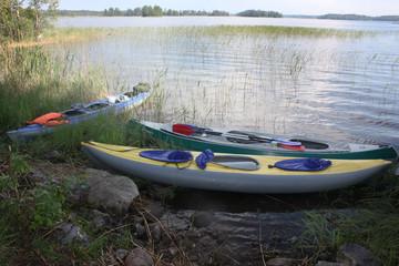 Three kayaks on the bank of Vuoksa.