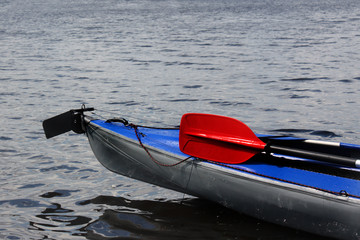 Blue kayak and red oar.