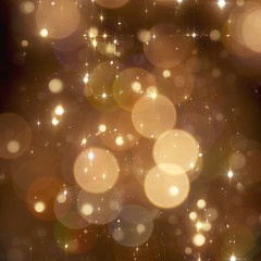 Christmas golden sparkle background with blured lights