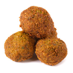 three whole falafel isolated on white