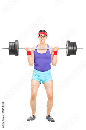 Determined guy lifting a heavy barbell