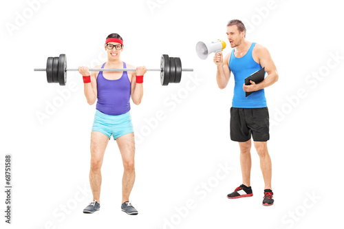 Fitness coach shouting at a guy through megaphone