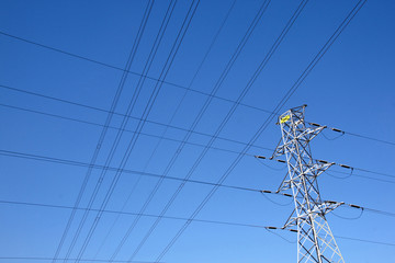 Network of Electric Cables Against Blue Sky