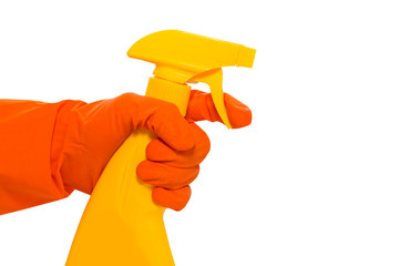 Hand in yellow protective glove holding spray bottle