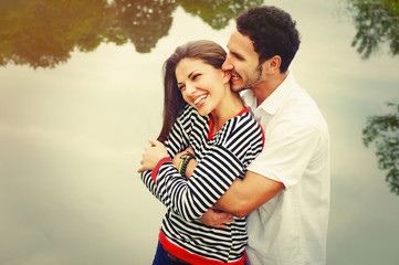 happy romantic wide smile couple in love at the lake outdoor on
