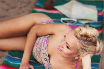 happy cute hot body young woman with colorful details lying on t