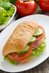 sandwich with ham and fresh vegetables, top view