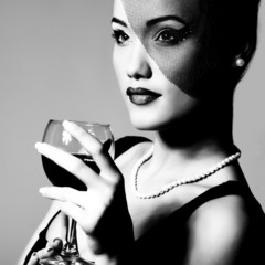 portrait of beautiful young woman with wine glass, black and whi