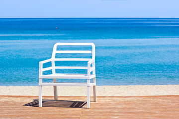 Plastic chair on the beach