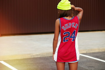 sexy woman girl in bright casual red basketball sport cloth