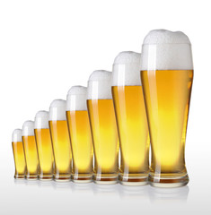 row of beer glasses on a white background