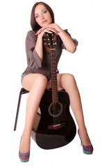 Beautiful young girl sitting with guitar