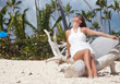 young beautiful woman in wedding dress on the exotic island