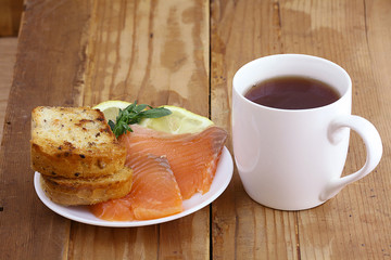 Breakfast tea sandwich with salmon