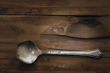 silver spoon on a wooden background