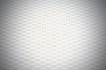 White cream plastic surface with repeating pattern.
