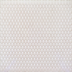 White cream plastic surface with a repeating pattern.