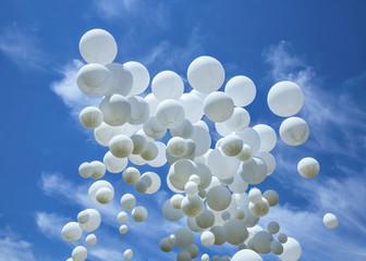 White balloons on the blue sky