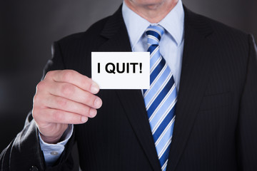 Businessman Showing Card With I Quit Sign