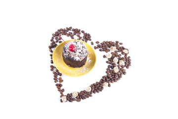 Delicious chocolate cake surrounded by heart shaped coffee beans