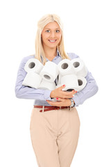 Woman holding a pile of toilet paper rolls