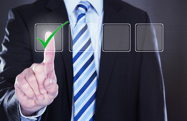 Businessman Pressing Check Mark Button