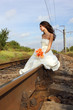 beautiful young bride on railway, summertime