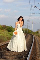 beautiful young bride on railway, summertime