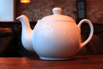 White tea kettle in the cafe