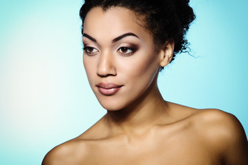 Young mulatto fresh woman with beautiful makeup