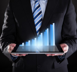 Businessman Holding Digital Tablet With Graph