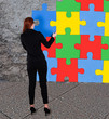 Businesswoman Solving Colorful Jigsaw Puzzle