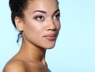 Young mulatto attractive calm woman with beautiful makeup, over