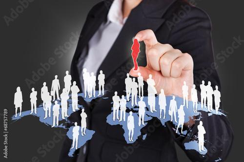 Leinwandbild Motiv Businesswoman Selecting Candidate From All Over The World