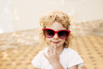 Little girl in red sunglasses, portrait