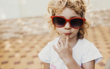 Little girl in red sunglasses, portrait