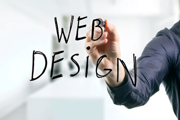 hand writing web design with black marker