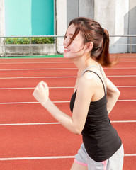 Chinese woman jogging, side view