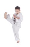 Young boy training kick isolated on white background