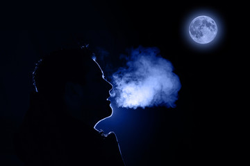 Man exhaling warm breath
