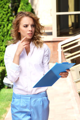 Businesswoman on city street