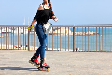 Rollerblading on the beach.