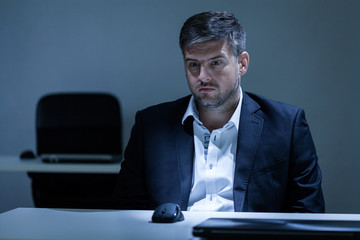 Man having depression at work