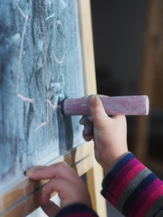 Child writing chalk